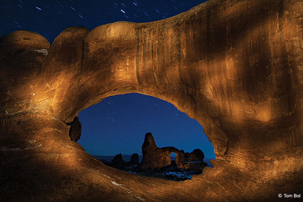 image of the night sky seen through a rock formation