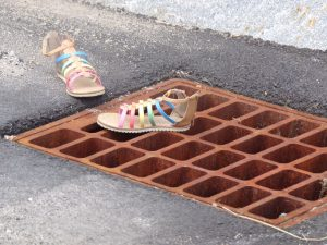 Sandals on a grate